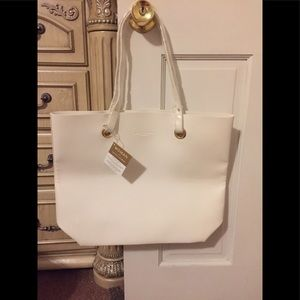 Woman by Ralph Lauren totes